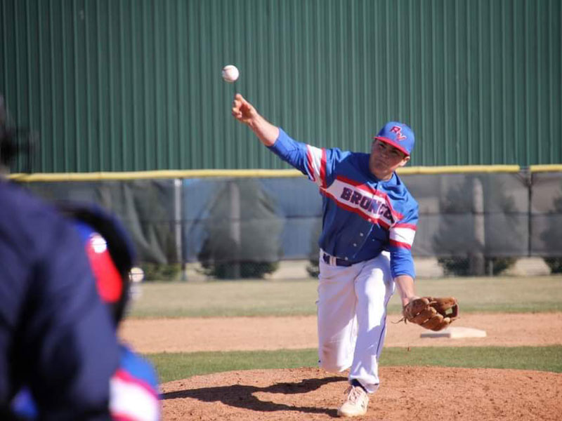 Russell/Victoria's Kaden Rome pitching in Colby on Thursday, April 1. (Photo courtesy Chris Roth)