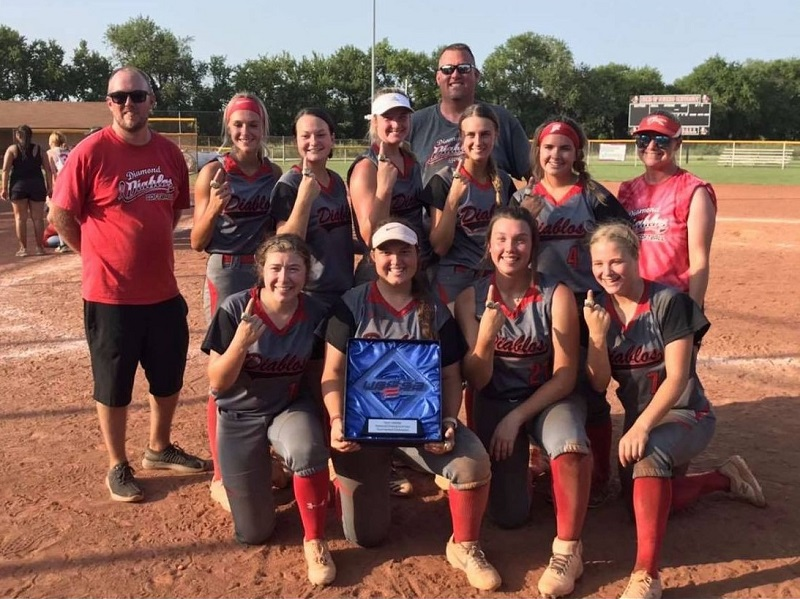 The Russell 18 and Under Diamond Diablos pose with their plaque after winning the USSSA 18 and Under National Championship on July 24, 2021 at the Two Rivers Youth Complex in Wichita, Kansas.