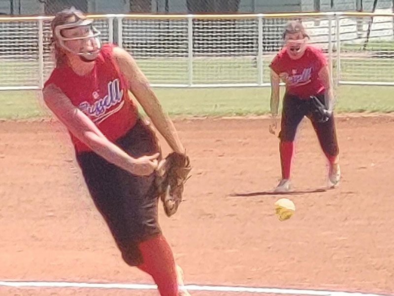 Russell's Kendra Bay pitching in Friday's first round game against Rooks County at K-18 State Softball Tournament in Lucas.